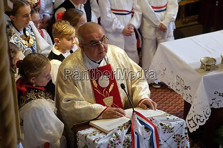 the priest preaches at the mass