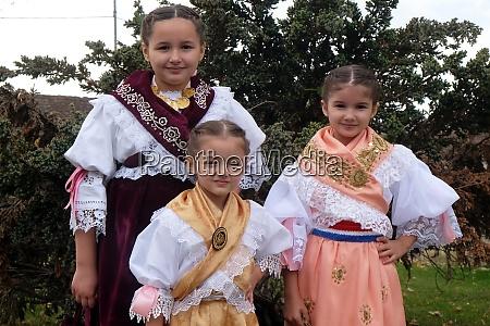 girls dressed in folk costumes go
