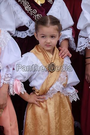 girl dressed in folk costumes go