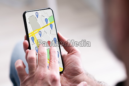 persons hand using gps navigation map