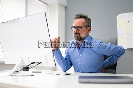 back pain at computer in office