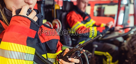 fire fighter woman on duty using