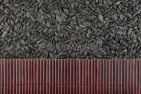 beautiful bamboo mat on sunflower seeds