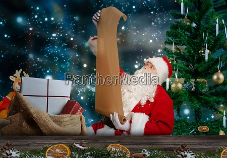 santa checks the wish list for