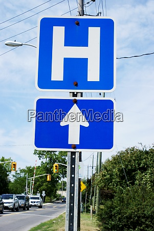 hospital direction street sign