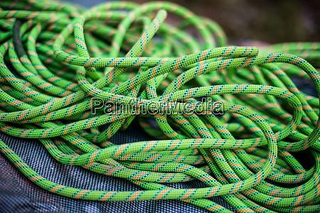 pile of green rock climbing rope