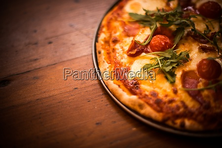 pizza on a wooden table