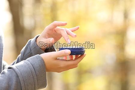 woman hand holding moisturizer cream bottle