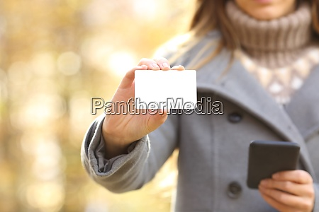 woman hands holding phone and showing