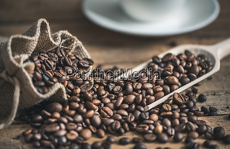 coffee beans spilled out of burlap