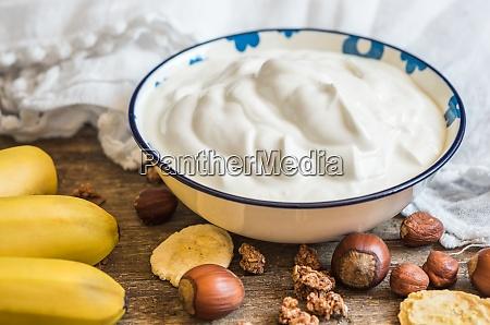 yogurt with muesli banana and nuts