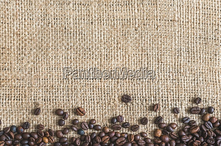 roasted coffee beans burlap background