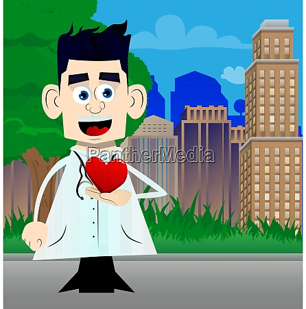 doctor holding red heart in his
