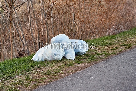bags of rubbish on the roadside
