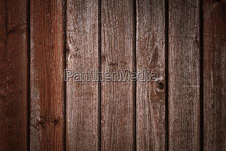 dark brown wooden background with old