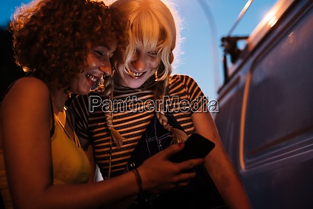 female couple looking at phone together