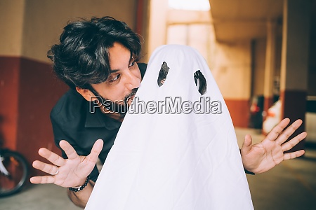 father with child dressed as ghost