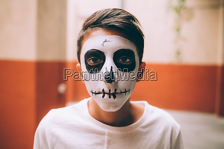 boy with halloween skull face paint