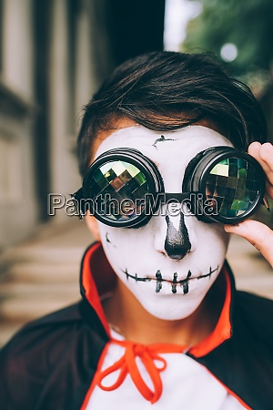 boy wearing halloween costume with face