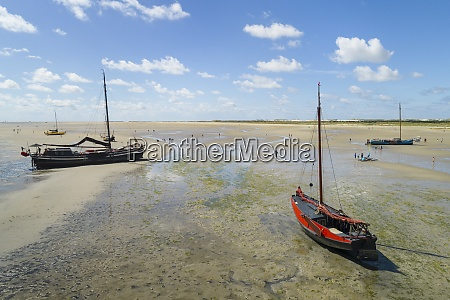 flatbottom sailing ships beached on the