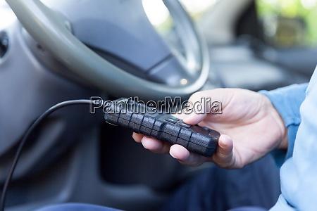 man using car diagnostic scan tool