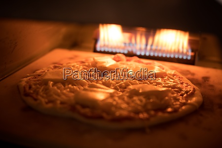pizza baking in an oven