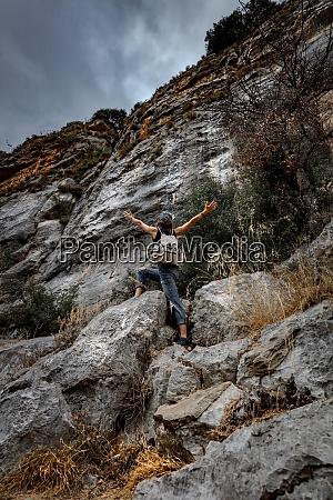 woman climbing the mountains