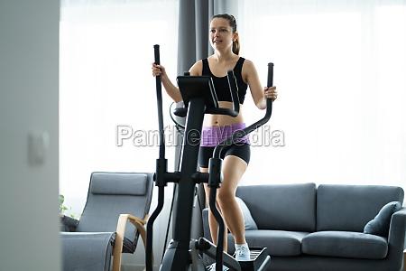woman training on elliptical trainer