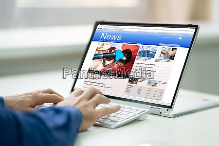 digital newspaper on convertible laptop screen