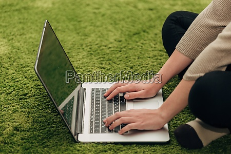 human hands placed over laptop