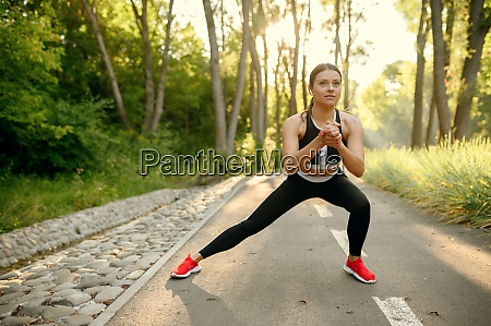 training in park woman prepares for