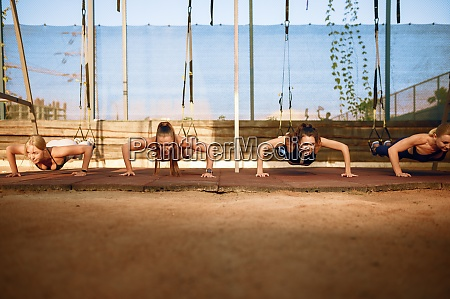 womens group doing push ups outdoors