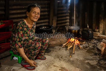 vietnamese woman at the fireplace in