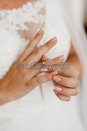 the bride gently touches her dear
