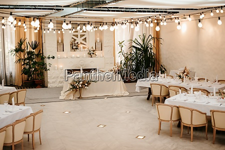 wedding ceremony area arch chairs decor