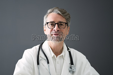 senior physician doctor video conference