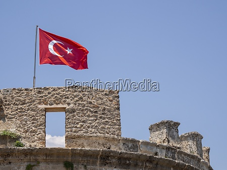 turkish flag on top of fortress