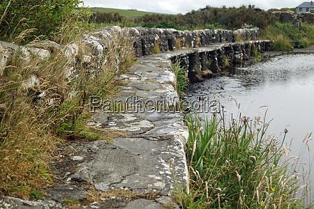 clapper bridge over carrownisky river ireland