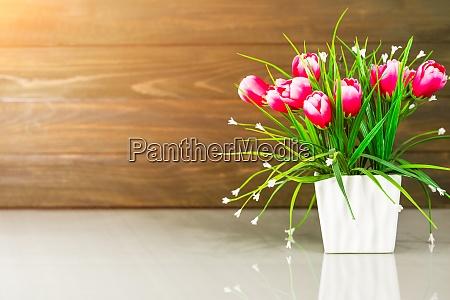 artificial flower vase bouquet over table