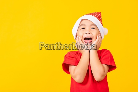kids dressed in red santa claus