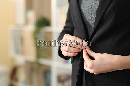 executive hand fastening button of suit