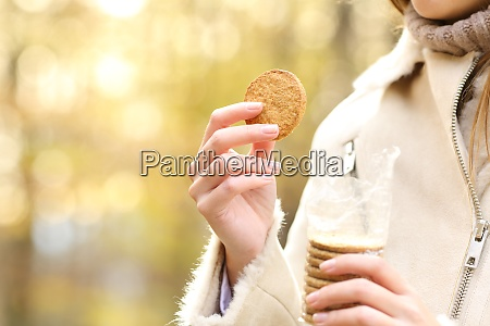 woman hand holding a cookie ready