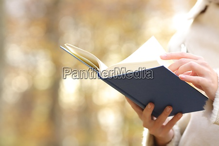 woman hands reading a book in