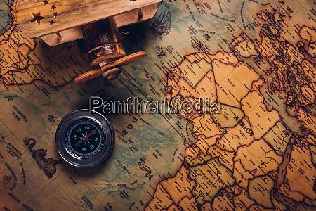 old compass discovery and wooden plane