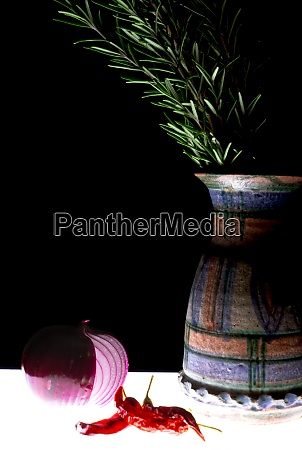 hand decorated terracotta vase with onion