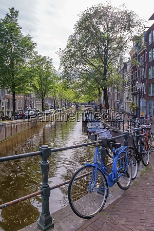 typical buildings canal and bikes in