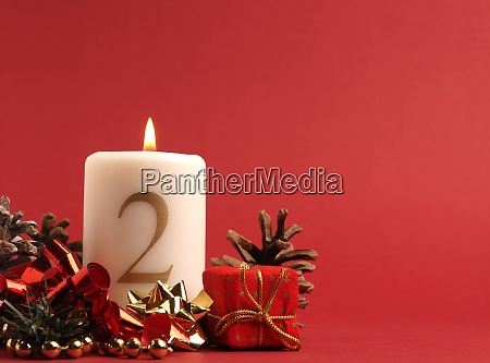 white candle with the number two