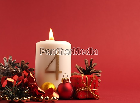 white candle with the number four