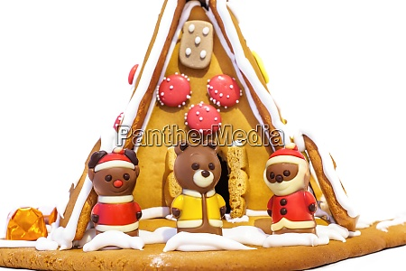 a cute gingerbread house with chocolate