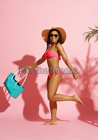 pretty woman in swimsuit poses with